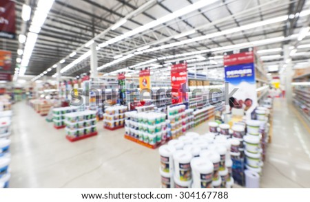 wide ankle view of home painting department at hardware store ,blur image. - stock photo