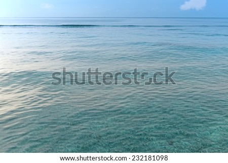 Wide blue sea and ocean view with transparent water and sun reflections - stock photo
