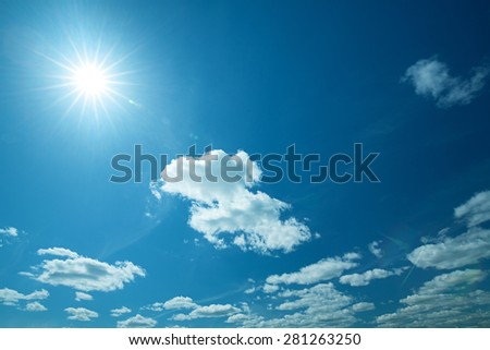 Wide blue skies and sun, abstract natural backgrounds - stock photo