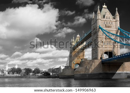 Wide daytime shot of Tower Bridge, London, UK, with a black and white background and the bridge in color