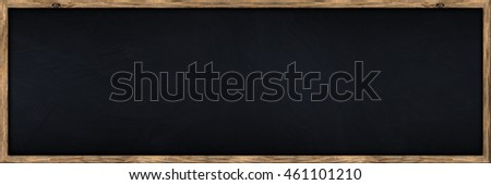 wide empty blackboard with wooden oak frame