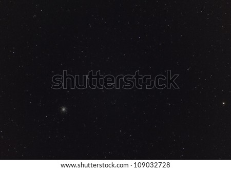 Wide Field View of the Hercules Globular Star Cluster - stock photo