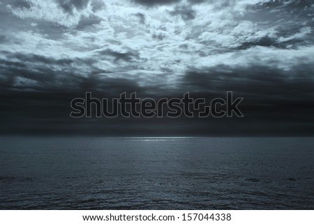 Wide minimalist view of ocean glistening in the horizon - stock photo