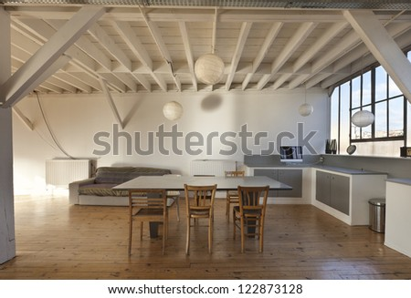 wide open space, beams and wooden floor - stock photo