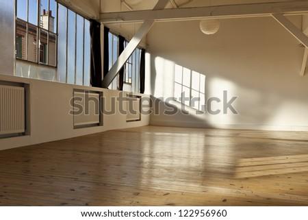 wide open space, beams and wooden floor - stock photo