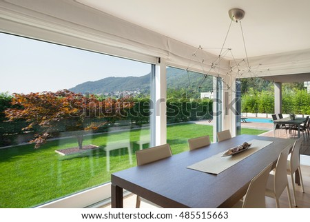 Wide open space of luxury house, veranda and garden view from the windows