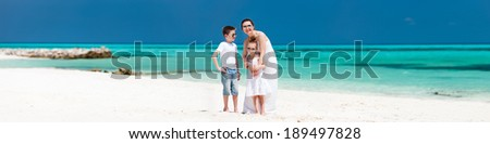 Wide panorama of mother and kids at tropical beach on summer vacation. A lot of copy space, perfect for banners. - stock photo