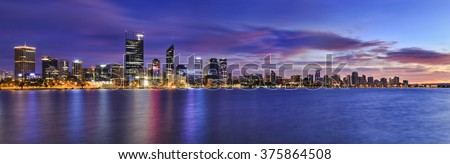 wide panorama of Perth city at sunrise. Business skyscrapers reflecting in still waters of swan river - stock photo