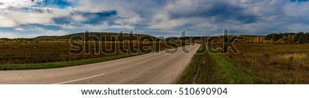 Wide panorama of road and hills, Autumn, Russia