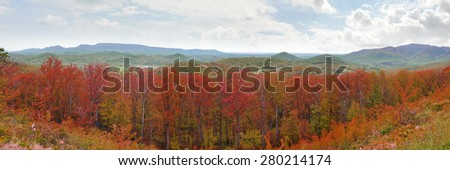 Wide panorama of the Appalachian Mountains with bright red autumn leaf colors - stock photo
