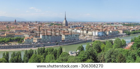 Wide panoramic aerial view of the city of Turin, Italy seen from the hill - stock photo