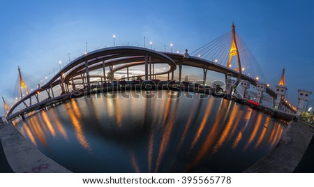 Wide panoramic of Bhumipol bridge real reflection with twilight blue sky