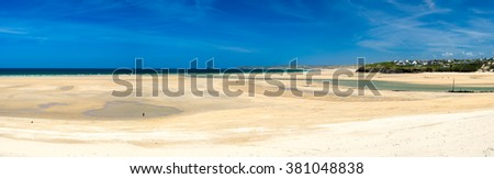Wide panoramic shot of the beautiful Porthkidney Sands Beach near Lelant in St Ives Bay Cornwall England UK Europe - stock photo