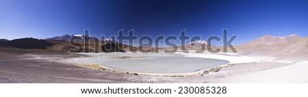 Wide panoramic view of Laguna Honda and surrounding volcanoes, Potosi region of Bolivia - stock photo