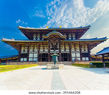 Wide path leading to front exterior facade of Great Buddha Hall, Daibutsuden on sunny, blue sky day in Todai-ji temple empty of people in Nara, Japan. Horizontal - stock photo