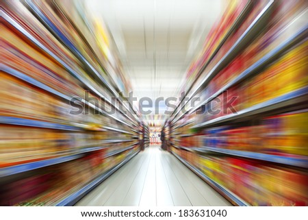 Wide perspective of empty supermarket aisle - stock photo