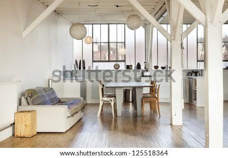 wide room of loft, beams and wooden floor - stock photo