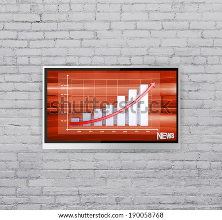 wide screen TV on brick wall with chart - stock photo