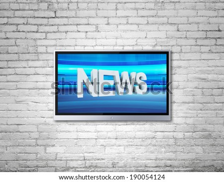 wide screen TV on brick wall with news - stock photo