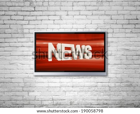 wide screen TV on wall with news - stock photo