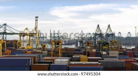 Wide shot of a busy Harbor with lots of Cranes and cargo containers - stock photo