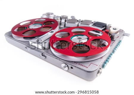 Wide shot of a reel to reel audio tape recorder on white background