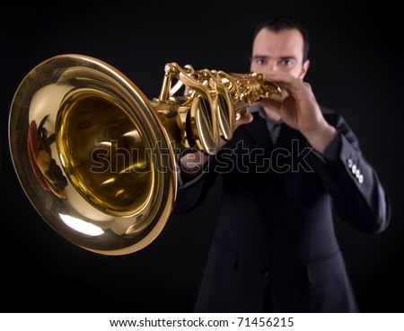 wide shot of male musician playing strait soprano saxophone - stock photo
