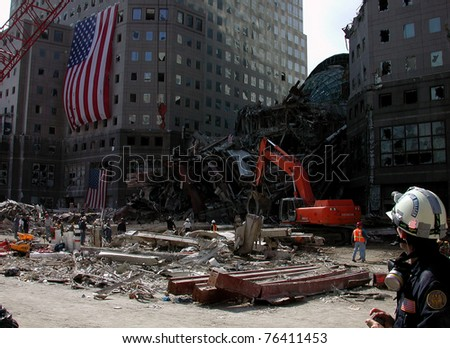 Wide shot of World Financial Center to include fallen glass domed atrium on 9-18-2001 - stock photo