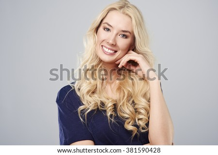 Wide smile of cheerful blonde - stock photo