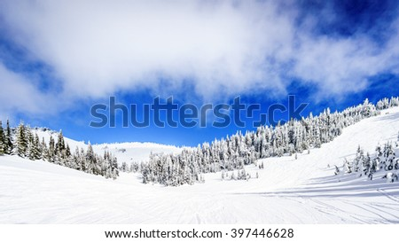 Wide snowfields and deep snow pack in the high alpine ski area at Sun Peaks in the Shuswap Highlands of central British Columbia, Canada - stock photo