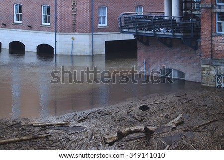Wide spread damage caused by flooding in the streets of York, United Kingdom - stock photo