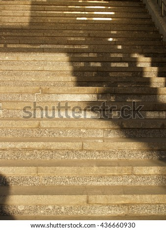 Wide stone stairway with pattern formed by shadows and highlights  - stock photo