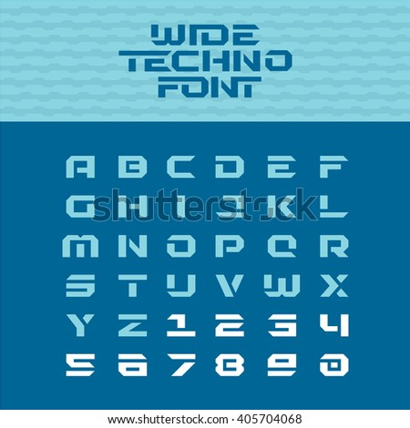 Wide techno poster font. Geometric angular letters with numbers. - stock photo