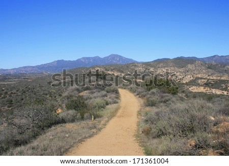 Wide trail leading through the hills, California - stock photo