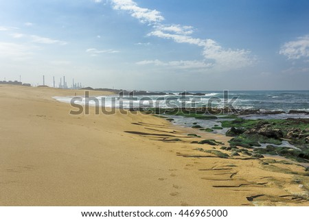 Wide view of a rocky sea beach from the north of Portugal - stock photo