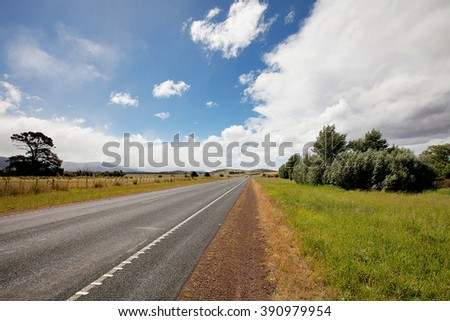 Wide view of empty rural Highway in central Tasmania, Australia