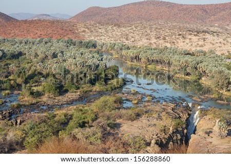 Wide view of Epupa waterfalls in summer time, the border of Angola and Namibia - stock photo