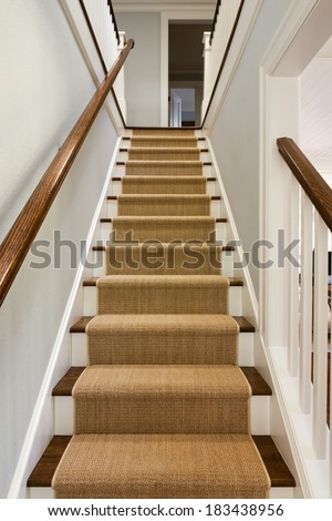 Wide View Wooden Staircase Carpet Runner Stock Photo