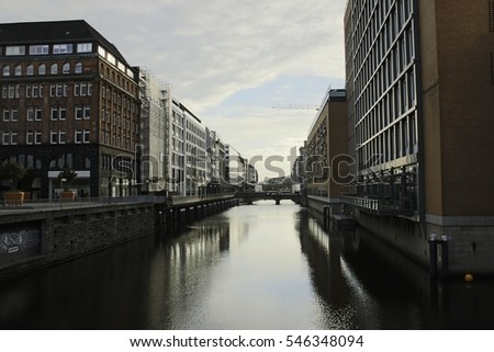 wide water channel industrial city with elegant architecture on its banks
