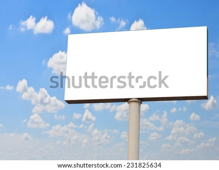 Wide white background of illuminated big blank billboard over cloudy blue sky
