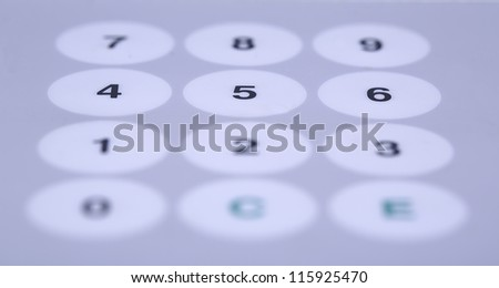 Wide white buttons on working desktop partially shaded - stock photo