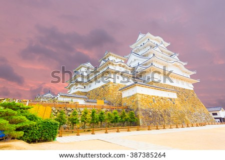 Wide yard below at the base of Himeji-jo castle on a colorful sunset evening in Himeji, Japan after newly renovated early 2015. Angled horizontal copy space