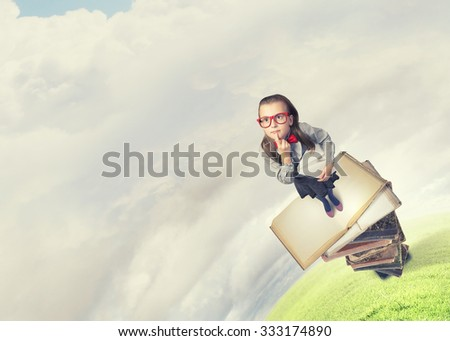 Wideangle picture of funny schoolgirl with paper plane in hand - stock photo