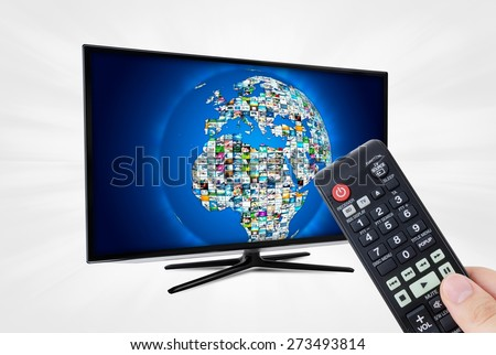 Widescreen high definition TV screen with sphere video gallery. Remote control in hand