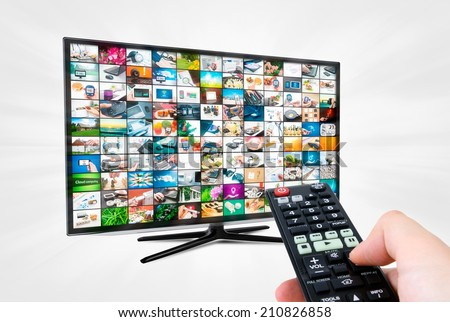 Widescreen high definition TV screen with video gallery. Remote control in hand - stock photo