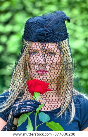 widow with veil and rose - stock photo