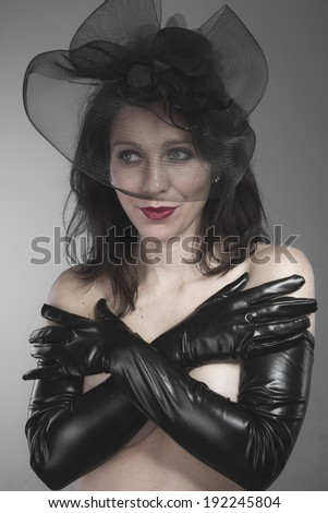 widow woman with black veil concept of death and loss - stock photo