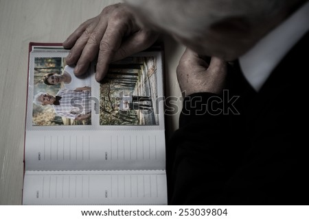 Widowed senior recollect happy memories of his wife - stock photo