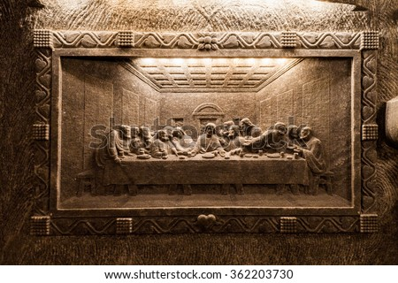 Wieliczka - Poland - April 23. One of the sculptures (The Last Supper) made in salt, located on the side wall of St. Kinga Chapel in Wieliczka Salt Mine Museum. Wieliczka - Poland - April 23, 2015. - stock photo