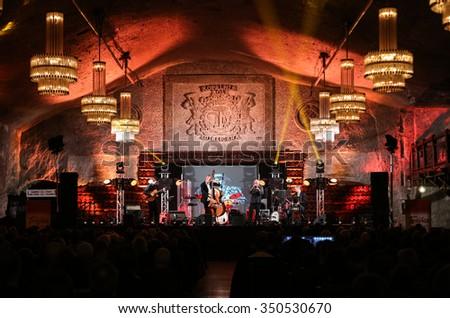 WIELICZKA, POLAND - NOVEMBER 2, 2015: Adam Kawonczyk Quartet playing live music at The Cracow Jazz All Souls Day Festival in The Wieliczka Salt Mine. Poland - stock photo